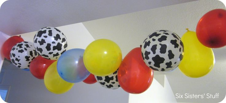 Good way to hang balloons without dealing with getting helium.  We blew up some balloons and tied a piece of fishing wire to a needle and threaded it through the end of each balloon.  So easy to hang!