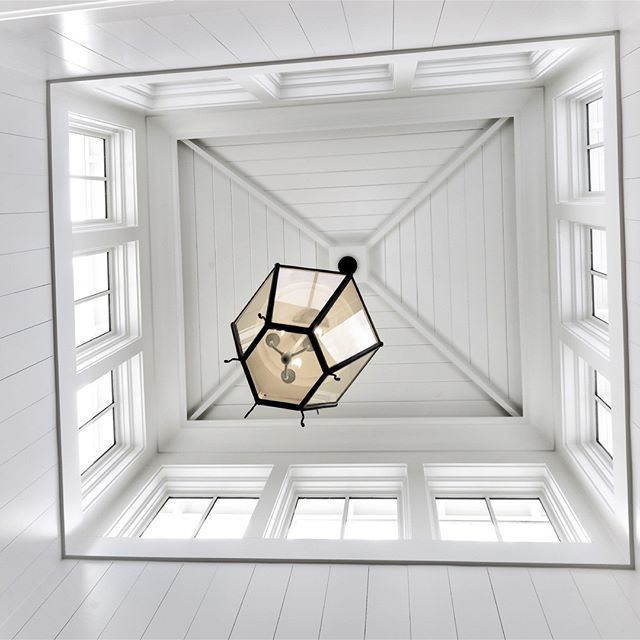 CUPOLA OVER STAIRWELL | Custom Iron Lantern, Shiplap Ceiling, Board and Batten Framed Walls over Shiplap Wrapped Stairwell.