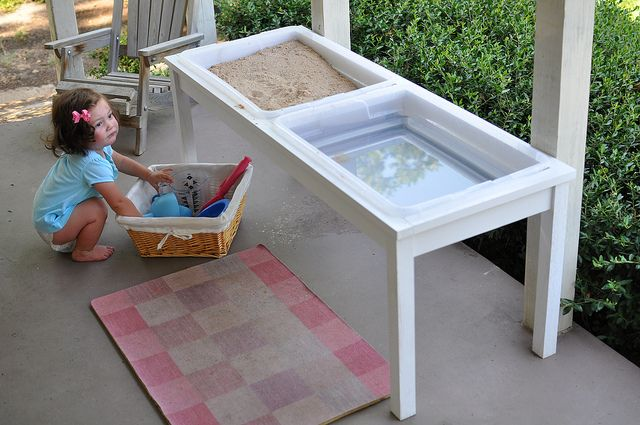 homemade sand and water table using storage totes so the lids can snap on