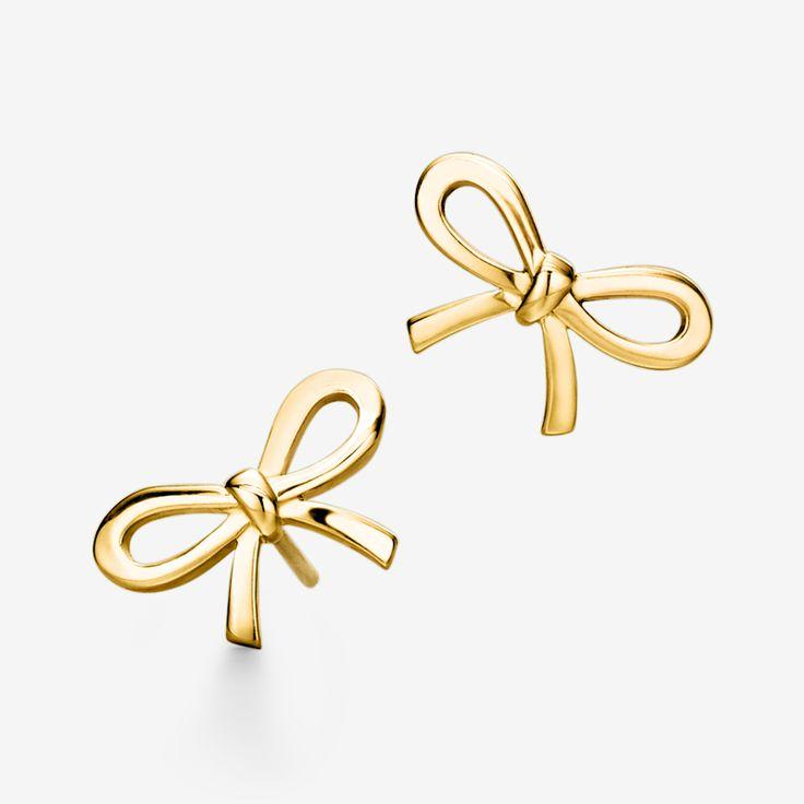 A golden couple. Tiffany & Co. bow earrings in 18k gold.