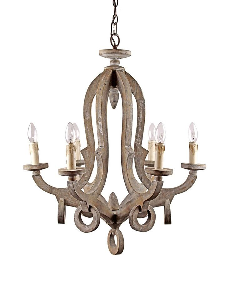 At first glance, the pendant light looks like an octopus; yet it has only six arms. Its wooden structure abounds with scratches and holes, rendering an antique look. Curving arms support candle shaped lights that cast pleasant and endearing glow when illuminated. The antique look of the pendant is complemented with dangling circle pieces that also carry scratches.
