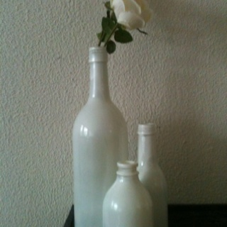 My own spray paint wine bottles! See original idea at thecolorfullivingproject.blogspot.