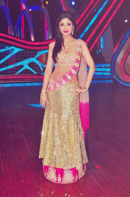 Shilpa Shetty in a gold and pink lehenga styled sari