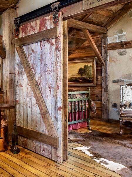 Totally digging this rustic cabin! Who else loves barn doors?
