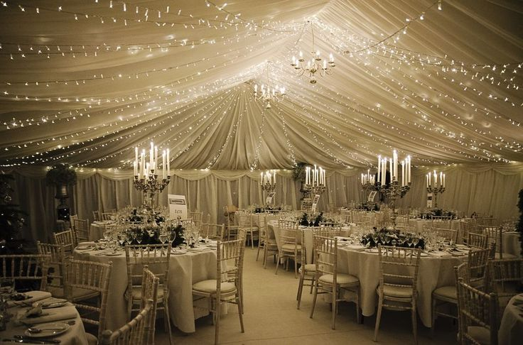 Pleated linings with fairy lights to create a beautiful winter wedding marquee