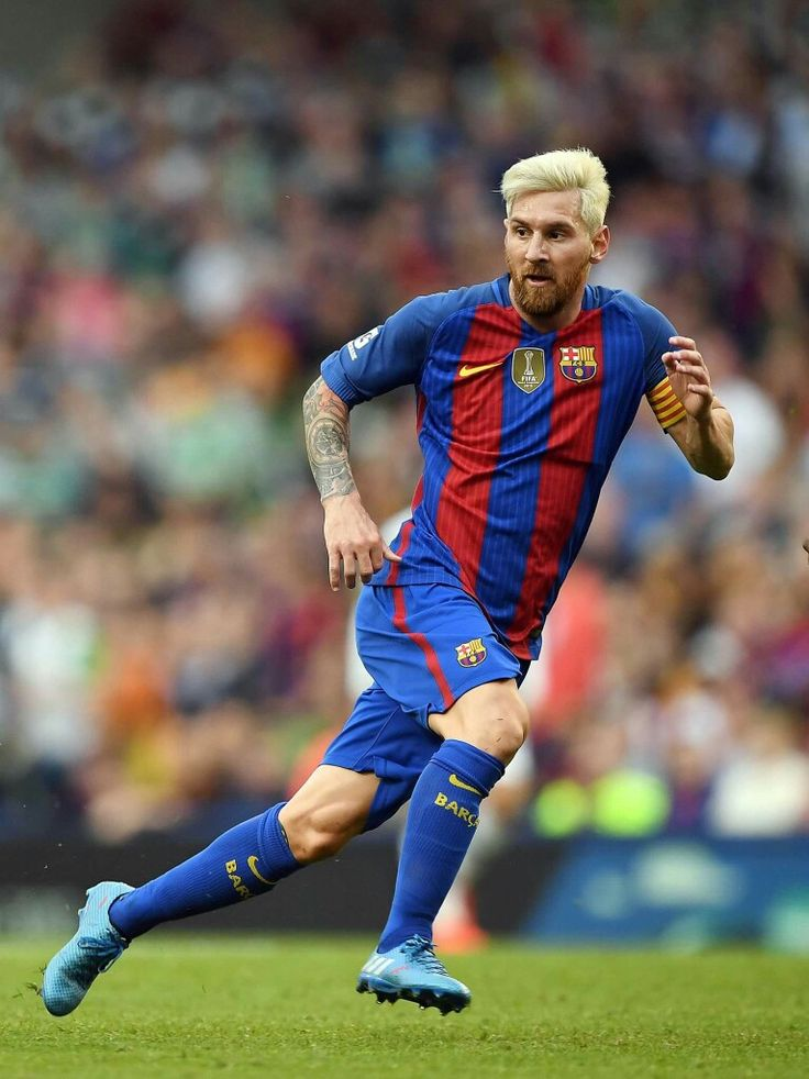 Even with the new hair style, Messi is worlds above the rest of the world in the art of futbol.