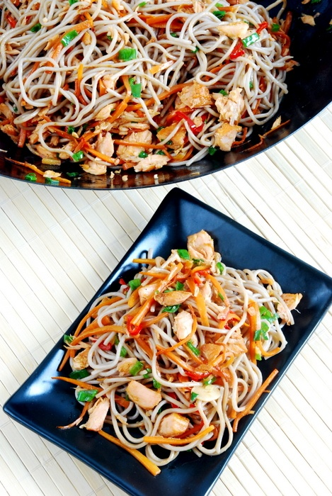 Soba noodles in wok with smoked salmon and some wegetables.