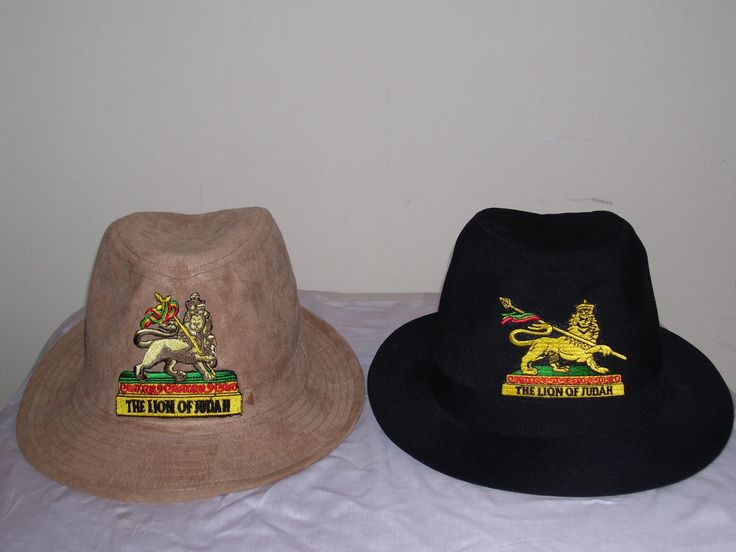 FEDORA MADE WITH COTTON ADORN WITH THE RASTAFARIAN SYMBOL LION OF JUDAH