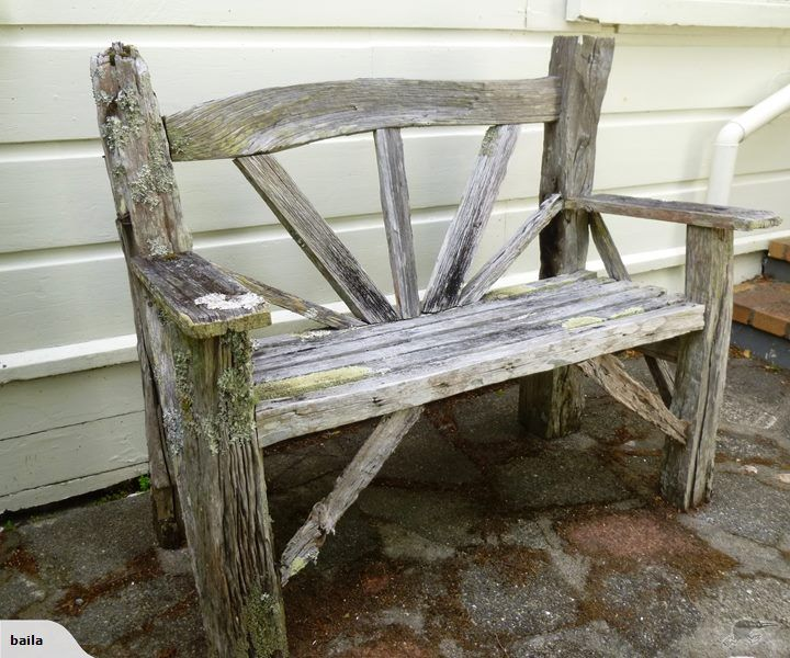 This is a rustic garden seat made of old totara fence for Garden fence posts ideas