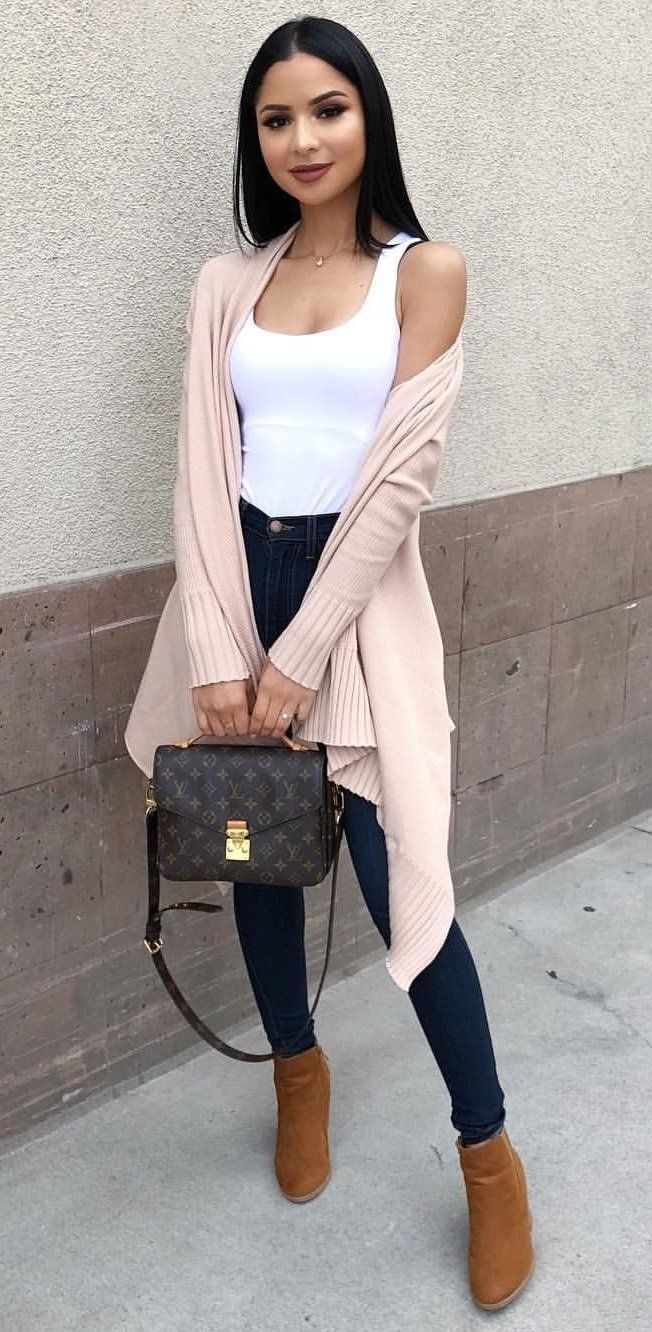 #fall #outfits  women's white sleeveless shirt , blue denim fitted jeans, pair of brown boots and gray cardigan outfit