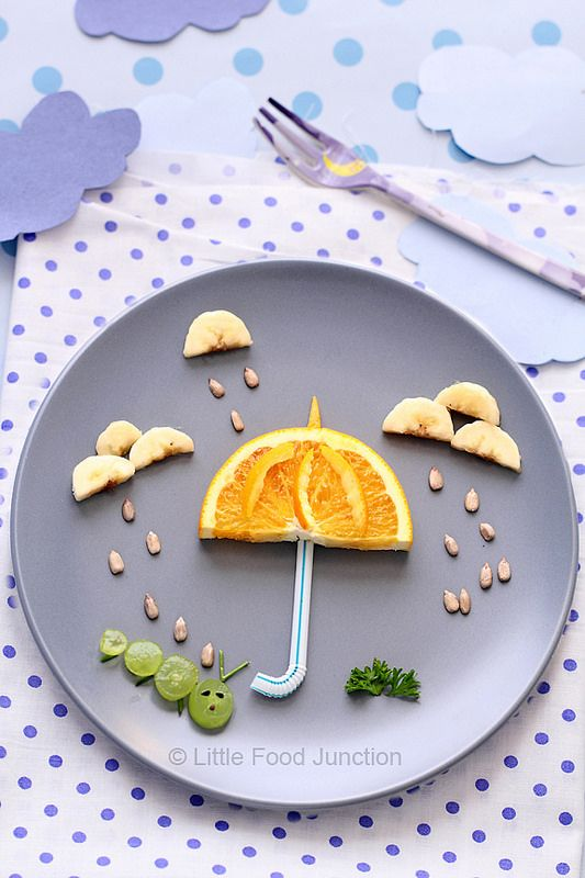 fun food for kids - use orange for an umbrella, bananas for clouds, and grapes for a caterpillar