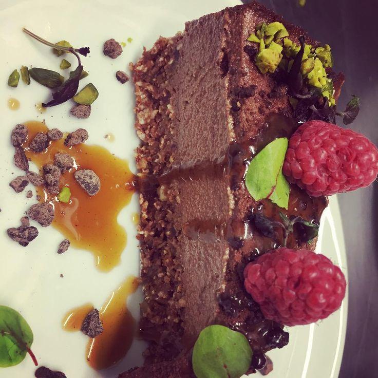 Raw Vegan Chocolate Cheesecake with Himalayan salted caramel sauce, pistachios & raspberries #eatateno