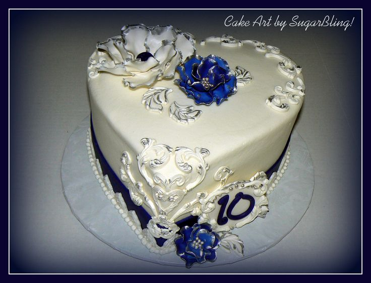 """This is amazing! Blue and Silver Anniversary - This is a 9"""" heart shaped cake frosted in buttercream and decorated with gumpaste flowers and molded decorations using the Wilton Baroque mold and Jennifer Dontz' pearl clay.  I love that stuff!"""