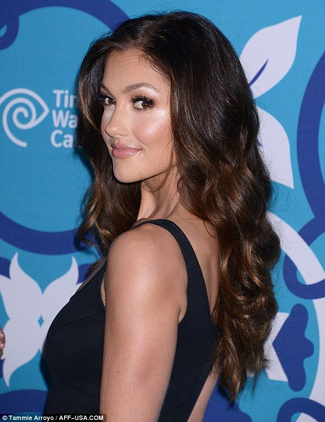 Perfectly polished: Boosting Minka's sex kitten aura, the star wore her much darker brown hair in voluminous cascading waves