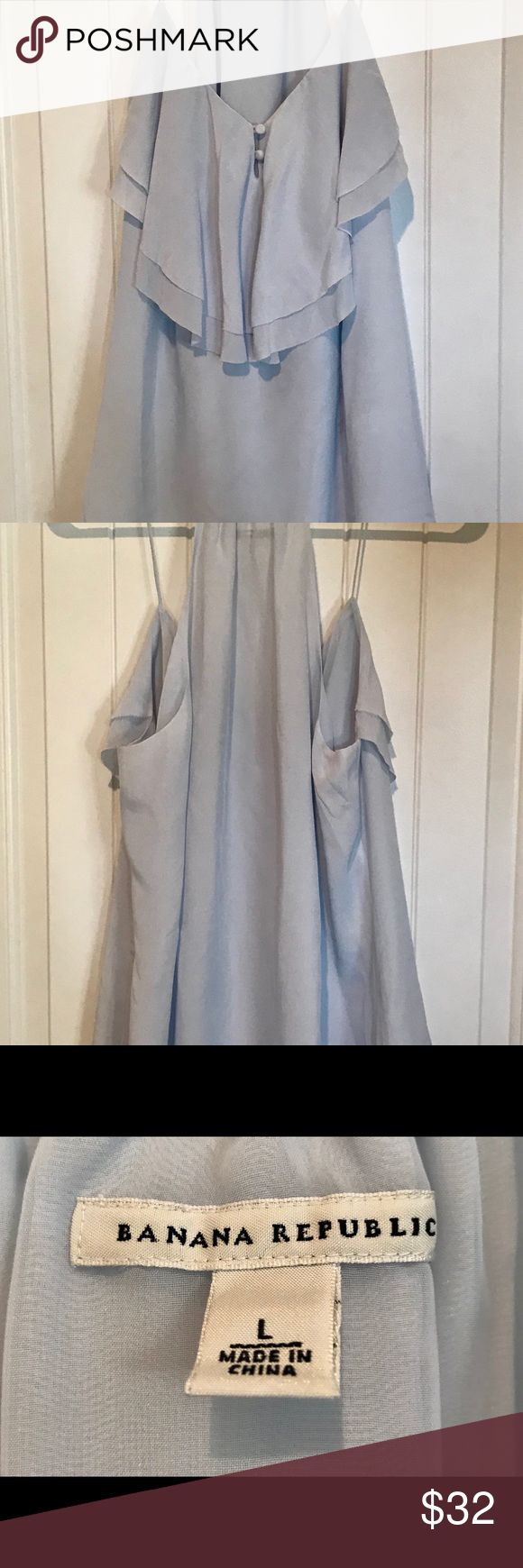 Silk Sexy Light Blue Strappy Top Luxury silk shirt for any occasion, covered buttons in front. Lined. Ruffled front. NWOT. Banana Republic Tops Blouses
