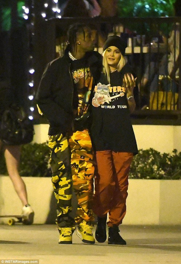 Keeping things casual!Kylie looked relaxed and content in her black beanie, Hooters T-shirt, and red trousers