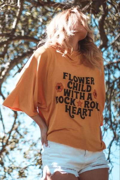 ed48b906 DETAILS Hey flower child, rock on in our Flower Child With a Rock & Roll  Heart sunset hoodie! A relaxed hoodie with wing sleeves in a roomy, slouchy  fit.