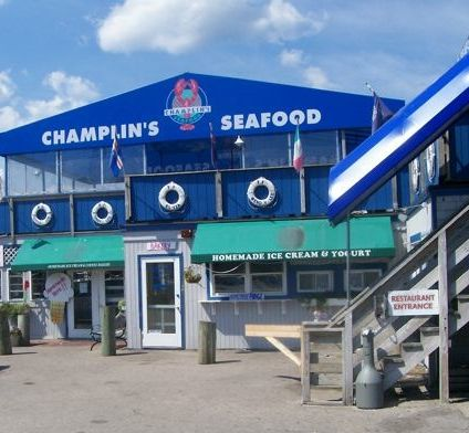 Champlin's Seafood, Narragansett RI, offers all kinds of seafood but its lobster and lobster rolls are the best. Champlin's is located in a live fishing village, so a lot of the seafood is fresh off the boat. The water views on the deck are nice in the summer. http://www.visitingnewengland.com/seafood.html