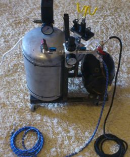 Homemade silent air compressor constructed from a refrigerator compressor, an air tank, and a pressure gauge