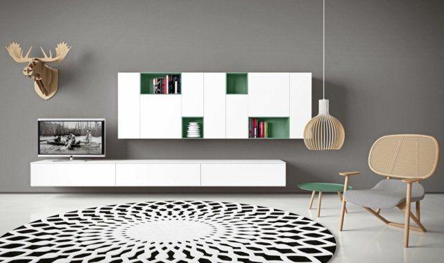 meuble modulable salon en blanc et vert, tapis rond en blanc et noir et suspension en bois moderne