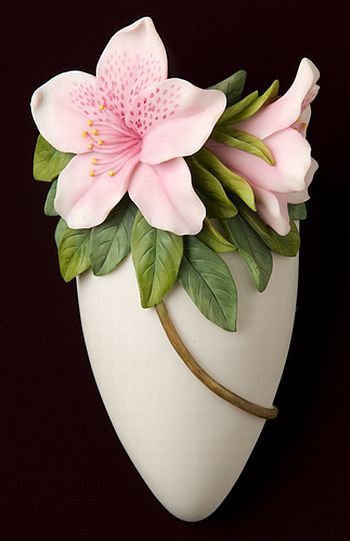 """Wall Vases from Ibis & Orchid Design are a strong, stable line. Each vase is beautifully sculpted, cast in bonded marble and hand painted in great detail. Wall Vase is approximately 3.5""""w x 7""""h."""
