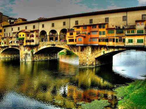 FLORENCE, ITALY - Love everything about this city (the people, the food....it's wonderful!), but I'm sure my favorite spot was sitting across from the Ponte Vecchio bridge.  Beautiful!  One day I must go visit again :)