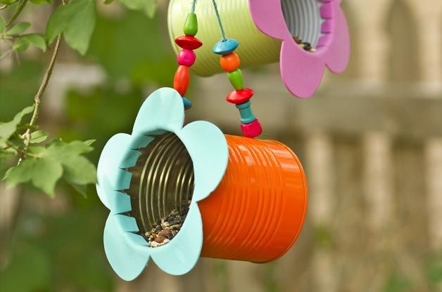Repurpose tin cans to make this cute yet functional bird feeder