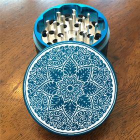 Turquoise 62mm Sharp-tooth Custom Herb Grinder. Laser engraved with a Mandala Design This smoking accessory is one of the most badass top shelf grinders in the cannabis industry today to make your own grinder check out customherbgrinders.com
