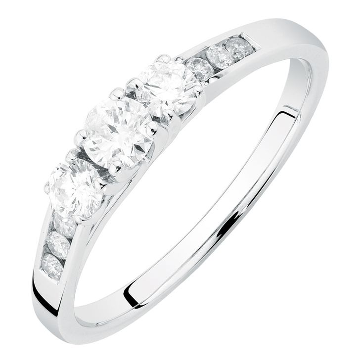 Celebrate your past, present and future with this lustrous ½ carat total diamond weight ring, featuring 3 round brilliant, claw-set diamonds, and further channel-set diamond shoulders, set in a 14ct white gold band.