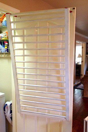 Repurpose an old crib into a drying rack. | 29 Incredibly Clever Laundry Room Organization Ideas