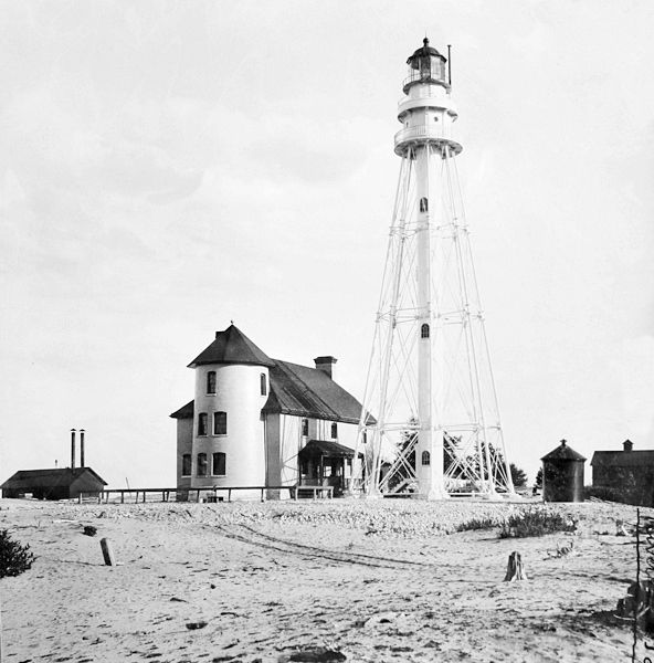 Photographs, history, travel instructions, and GPS coordinates for Rawley Point (Twin River) Lighthouse.