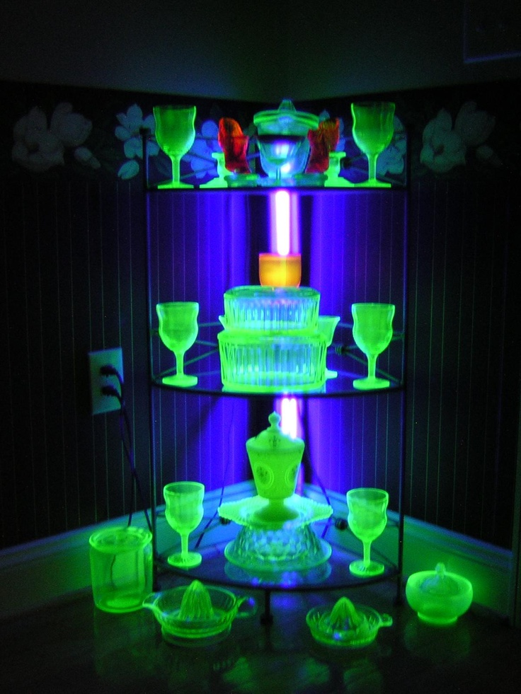 Just some Uranium glass in UV light.  Drink anyone? [Read more about uranium glass and all the various types of it here: http://en.wikipedia.org/wiki/Uranium_glass] ️  LO