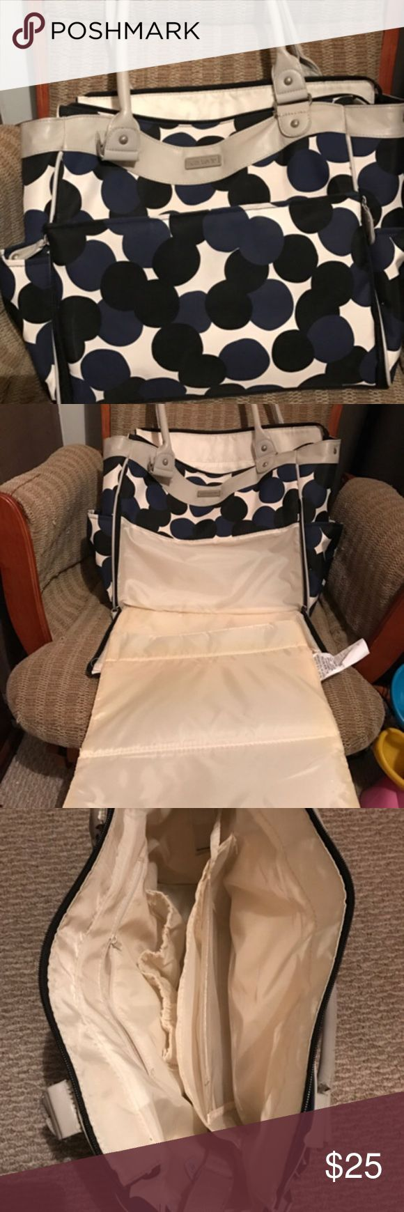 Carter's Polka dot diaper bag Very seldom used. Great condition, no wear & tears, smoke free home. White bag w/ black & blue polka dots. Side unzips to fold out a changing pad. Comes with wet/dry bag. Plenty of storage! Carter's Bags Baby Bags