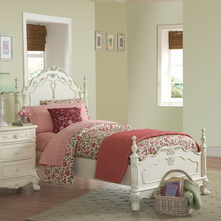 Bed with Victorian styling, floral motif hardware, ecru painted finish and traditional carving details
