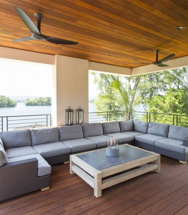 Outdoor living room with black composite Haiku fans