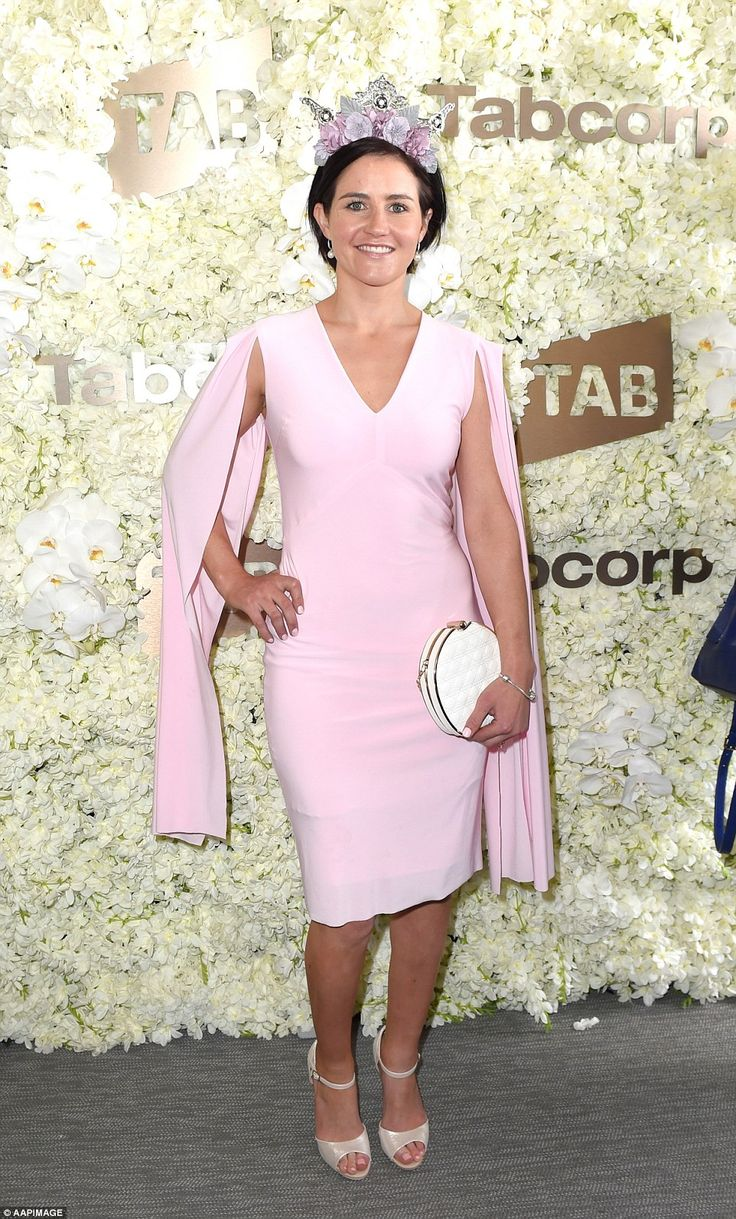 In the pink! Elsewhere, Jockey Michelle Payne arrived at the Birdcage in a pink pencil dre...