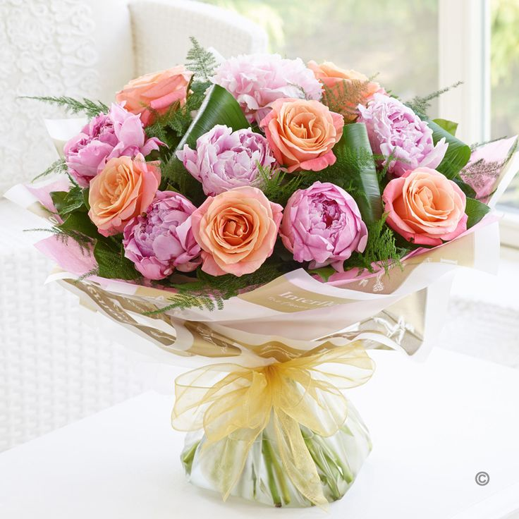 This bouquet of soft pink peonies and divine peach and pink roses really is a match made in heaven | Booker Flowers and Gifts | Free Flowers Delivery Liverpool