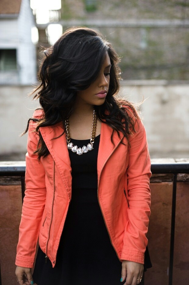 Bright coral jacket on black with pearl necklace. Interesting combination of night/day dark/bright.