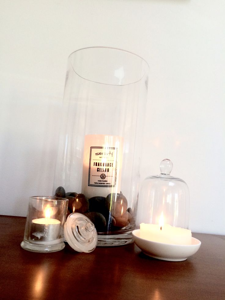 Beautiful candle display.  very easy, very effective and modern.  Simple white candle river stones and glass feature vase.