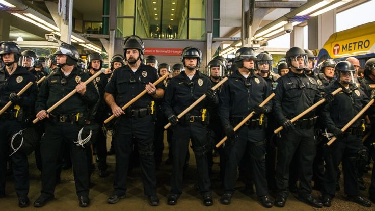 PEOPLE WAITING FOR SOMETHING TO HAPPEN - Riot police at a Black Lives Matter Protest at Mall of America