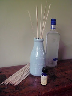 Homemade Reed Diffuser uses no oil.  Incredibly cheap as I had all the supplies, even a really cute olive oil bottle.  Can already smell the essential oil.