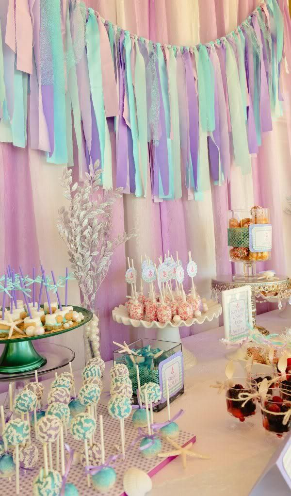 Adorable party backdrop made of strips of fabric and ribbon. #girlbirthdayideas #puprleparty #partyideas #partydecor