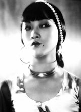 Anna May Wong  Date of birth: 1905   Date of death: 1961  Anna May Wong was an American actress and the first Chinese-American movie star. Born in LA's Chinatown, Wong started acting in the silent era, appearing in The Thief of Bagdad alongside Douglas Fairbanks