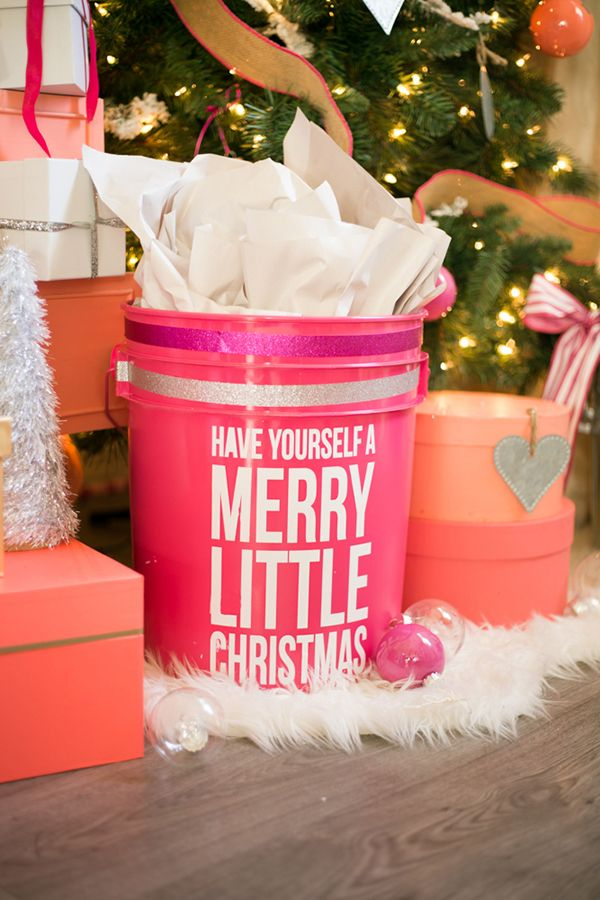 """What a great gift wrapping idea! Destiny Alfonso of Just Destiny Mag painted a white plastic bucket pink and added a holiday message with stick-on letters. She has other clever """"wrapping"""" ideas on The Home Depot Blog."""