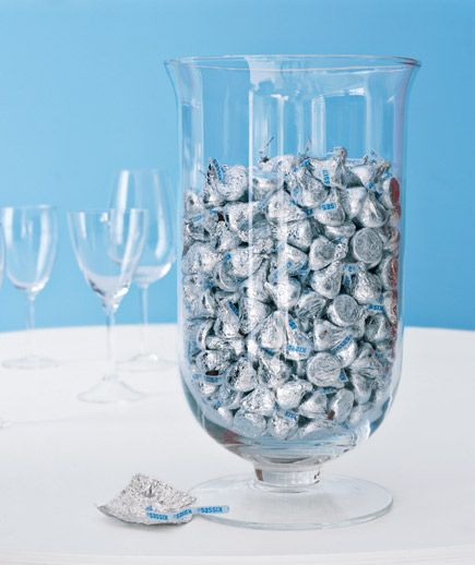 Hershey Kisses in a vase - you could do all different candies in pretty colors.