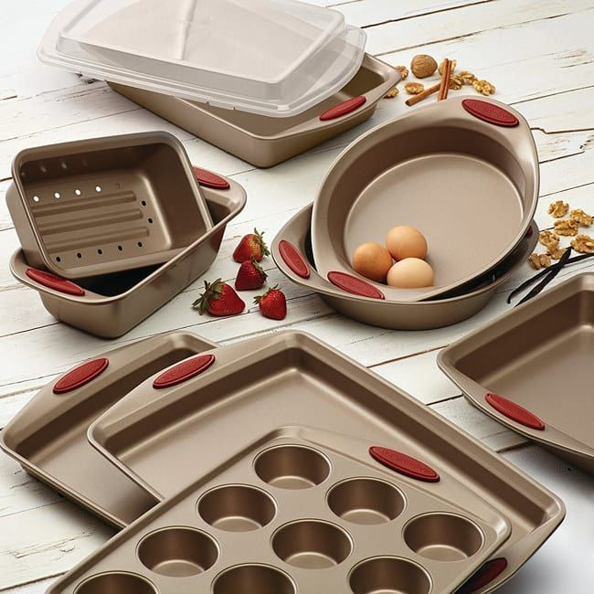 "The 10-piece set of rolled-rim bakeware is oven-safe up to 450 degrees and dishwasher-safe, with each piece featuring silicone grips for easily handling. But it is recommended you hand-wash the pieces. The set includes two baking sheets, two round cake pans, a square cake pan and rectangle cake pan with a plastic top, a two-piece loaf pan, and a muffin pan. Promising Review: ""This is a great bakeware set! Aside from the color, which I love, they are easy to clean and nothing sticks to them…"