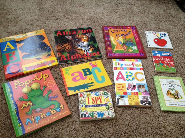 LETTERS/PHONICS: great books for teaching letters/phonics.  Center yellow book created on Shutterfly with photos with friends and objects that match each letter of the alphabet.