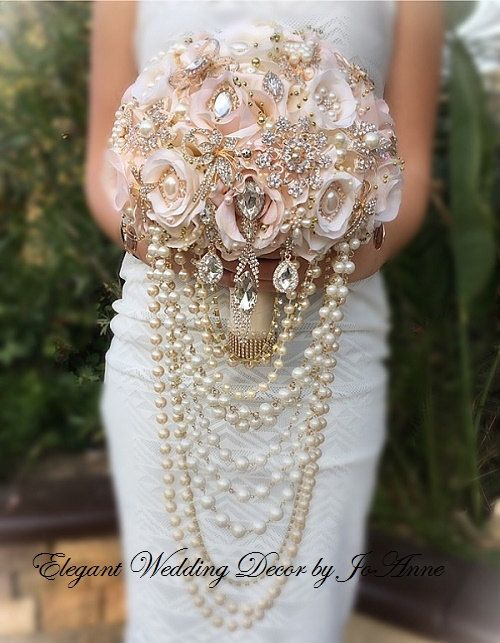 ROSE GOLD DRAPING BROOCH BOUQUET - $550 (Total Price) Custom Rose Gold Draping Bridal Brooch Wedding Bouquet. All Custom Handmade Design with Blush and Ivory Flowers with all Rose Gold and Gold Brooches and Gems with Draping, Cascading Pearls. This is a Large 9.5 Size (28 in Circumference). This Design can be customized. Please do allow 5-8 Weeks for the production of your Bouquet. Rush Orders please contact shop. - Deposit when Placing your Order - $350.00 - Balance - $200 Payable once…