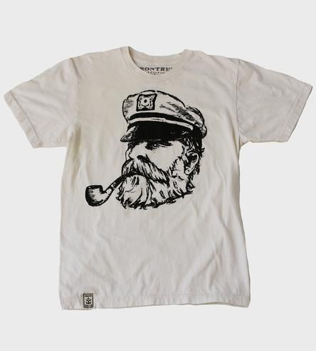 The Old Sea Captain, long a mysterious and strong archtype of man's need to be one with and challenge the sea.This natural, organic men's t-shirt features his likeness.