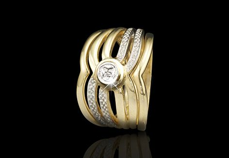 A wedding set with open rows of 9ct yellow gold, encrusted with diamonds.